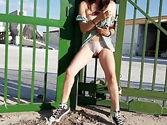 Muddy chick wets her subjugation with a big squirt outside a factory