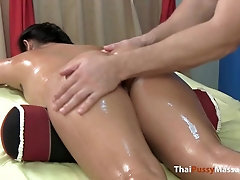 Lil' Thailand bombshell has her whole bod oiled up and rubbed