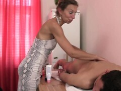 60 years old massagist satisfies her client