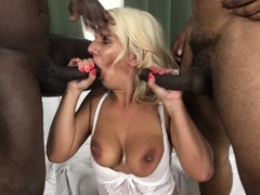 Mom gets nailed by 2 dark-hued guys in the same time